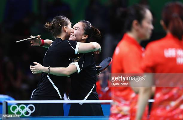 Petrissa Solja and Xiaona Shan of Germany celebrate after winning match point against Hong Kong during the Table Tennis Women's Team Round Quarter...