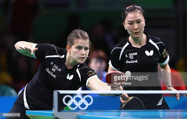 Petrissa Solja and Xiaona Shan of Germany play agsinst Hong Kong during the Table Tennis Women's Team Round Quarter Final between Germany and Hong...