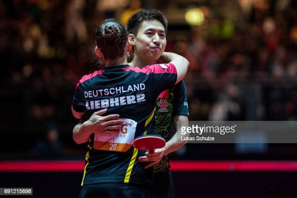 Petrissa Solja of Germany and Bo Fang of China celebrate their win of the quarter final at Table Tennis World Championship at Messe Duesseldorf on...