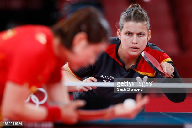 Petrissa Solja of Team Germany in action against Chen Meng of Team China during her Women's Team Semifinal table tennis match on day twelve of the...