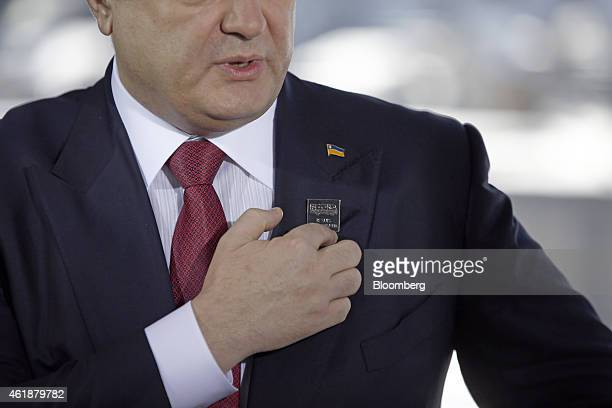 Petro Poroshenko billionaire and Ukraine's president points to a lapel badge that reads 'Je Suis Volnovakha' during a Bloomberg Television interview...