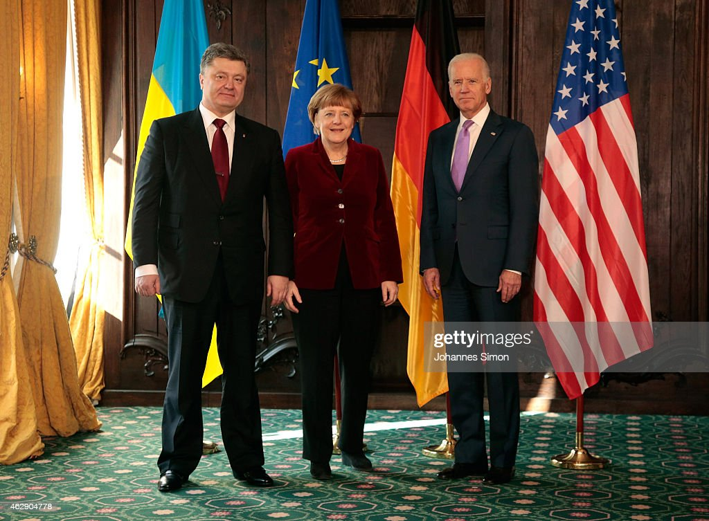 Petro Poroshenko, president of the Ukraine, German Chancellor Angela Merkel and US Vice President Joe Biden pose ahead of a bilateral meeting at the 51st Munich Security Conference (MSC) on February 7, 2015 in Munich, Germany. Foreign ministers and defense ministers from countries across the globe are meeting to discuss current global security issues, in particular the crisis in eastern Ukraine, the spread of ISIS in Syria and Iraq and the large-scale movement and plight of refugees.