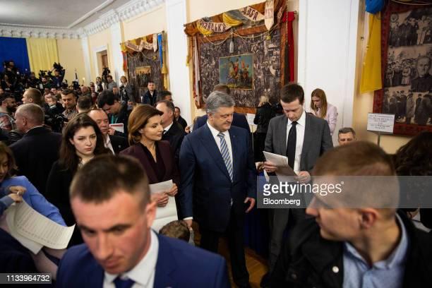 Petro Poroshenko Ukraine's president arrives at a polling station to cast his vote in Kiev Ukraine on Sunday March 31 2019 Ukrainians will choose...