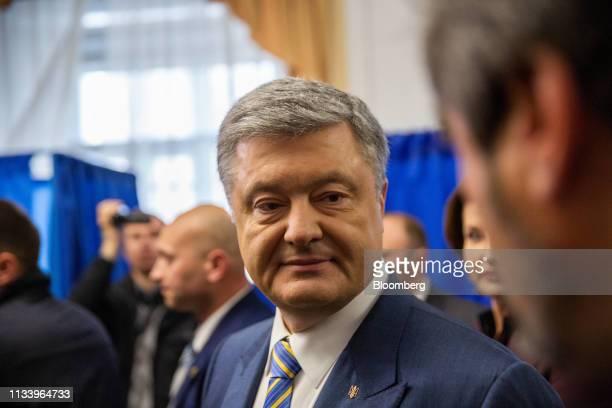 Petro Poroshenko Ukraine's president leaves a polling station after casting his vote in Kiev Ukraine on Sunday March 31 2019 Ukrainians will choose...