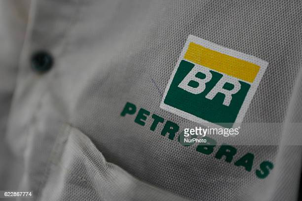 Petrobras logo in employee's uniform Executives of Brazilian state oil company Petrobras and Bolivian counterpart YPFB signed this week a contract...