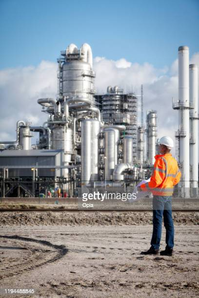 petrochemical inspector with drawing - oil refinery stock pictures, royalty-free photos & images