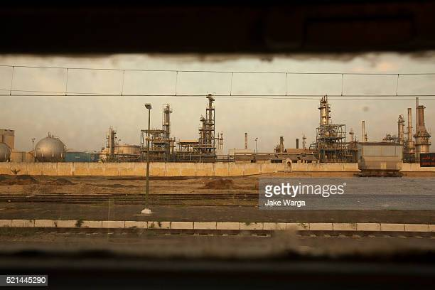 petrochemical plant seen from train window, morocco - jake warga stock pictures, royalty-free photos & images