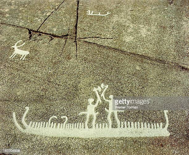 Petroglyph depicting phallic figures on board a ship apparently performing a ceremonial axe dance Bronze Age Boat Axe culture Petroglyph depicting...