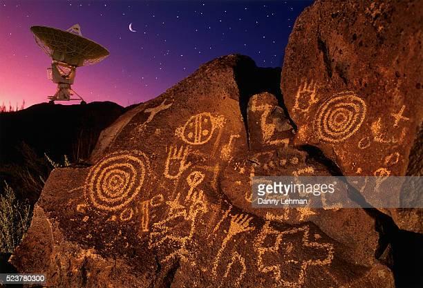 petroglyphs and radio telescope - pintura rupestre fotografías e imágenes de stock