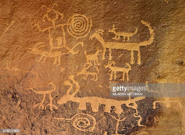 Petroglyphs made by Ancient Puebloan People are seen on the rocks at Chaco Culture National Historical Park on May 20 2015 AFP PHOTO / Mladen ANTONOV