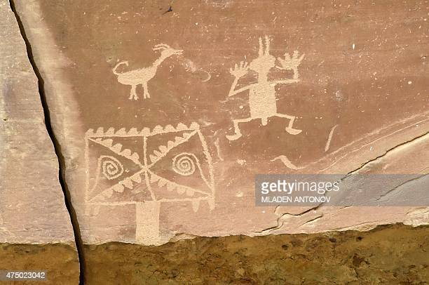 Petroglyphs made by Ancient Puebloan People are seen on the rocks at Chaco Culture National Historical Park on May 20, 2015. AFP PHOTO / Mladen...