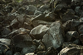 Petroglyphs of animals on a rock in Geghama mountains, Armenia, Caucasus.