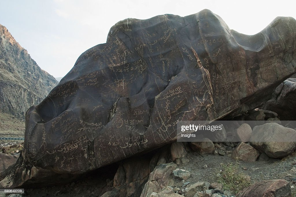 Petroglyphs On A Boulder Show Sogdian And Brahmi Inscriptions. : News Photo