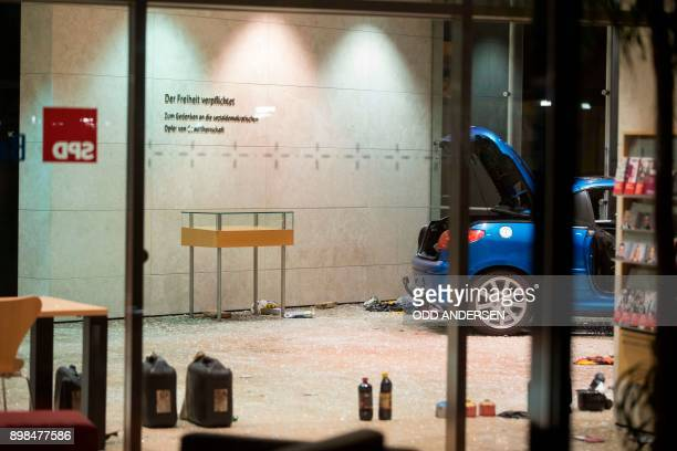 Petrol and lighter fluid canisters are seen next to a car in the lobby of the German Social Democratic Party headquarters after a vehicle was used to...