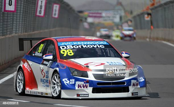 NIS Petrol by Campos Racing driver Dusan Borkovic of Serbia steers his car during a training session as part of the FIA World Touring Car...