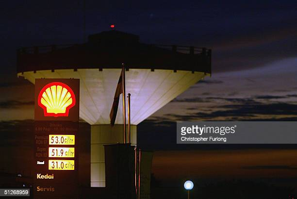 Petrol gas station is pictured amongst oil and gas processing facilities at Seria, September 7, 2004 in Brunei. Brunei produces around 218,000...