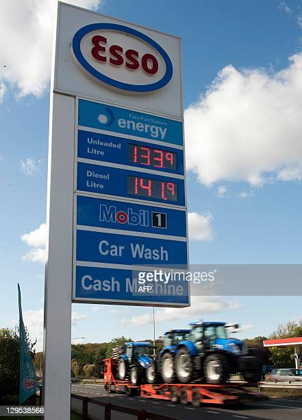 Petrol prices are pictured at a petrol station in Essex east of London on October 18 2011 Britain's annual inflation surged to 52 percent in...