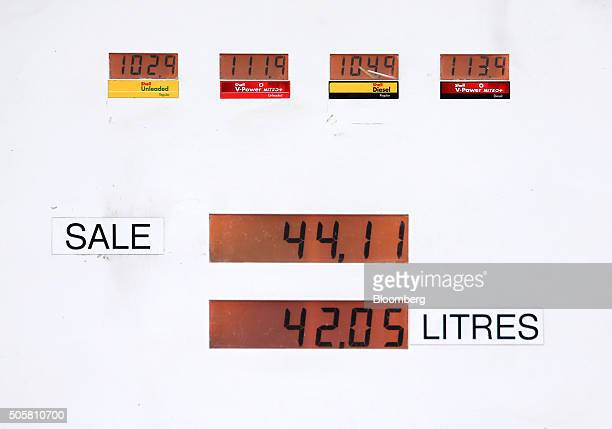 A petrol pump displays prices of different fuel types and the volume of fuel of the last sale on the forecourt of a Royal Dutch Shell Plc gas station...