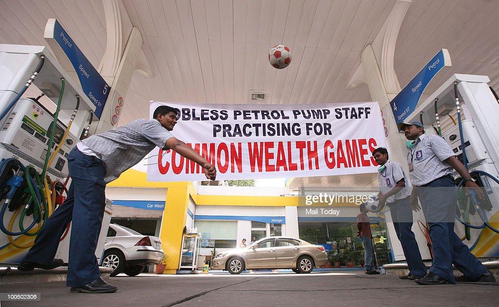 A petrol pump workers play games during petrol pump dealers' strike in New Delhi on May 24, 2010.