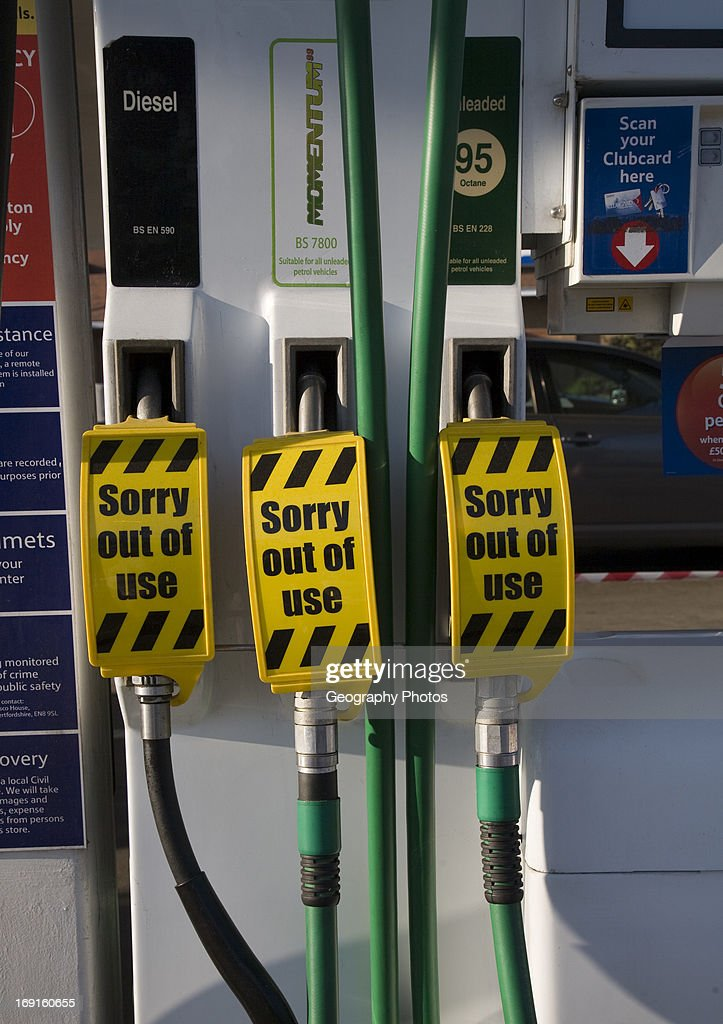 Petrol pumps with sign saying no fuel available News Photo