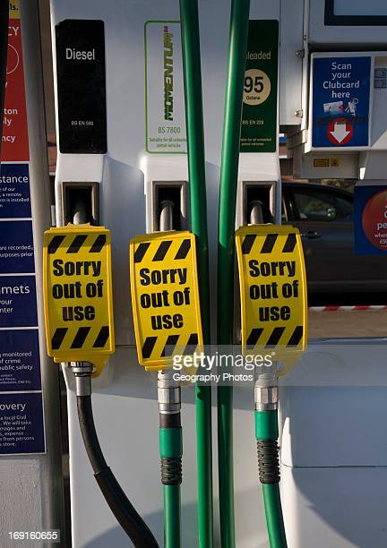 Petrol pumps with sign saying no fuel available