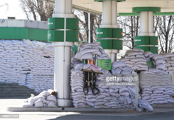 A petrol station is lined with sandbags to protect dispensers from explosions in Donetsk capital of the selfproclaimed Donetsk People's Republic on...
