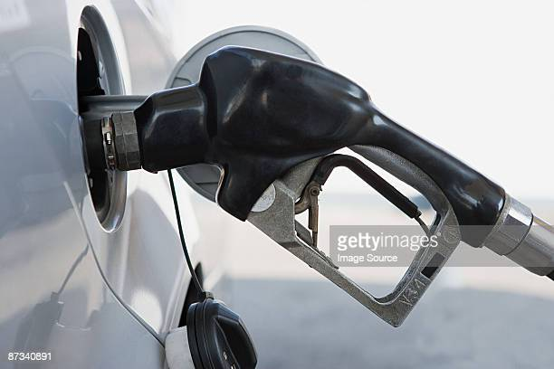 a petrol tank being filled - gas tank stock photos and pictures