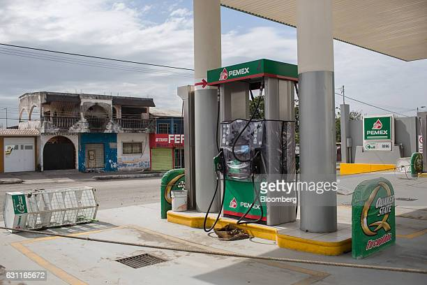 A Petroleos Mexicanos gas station stands roped off after looting in Veracruz City Mexico on Saturday Jan 7 2017 Mexico's National Association Of...