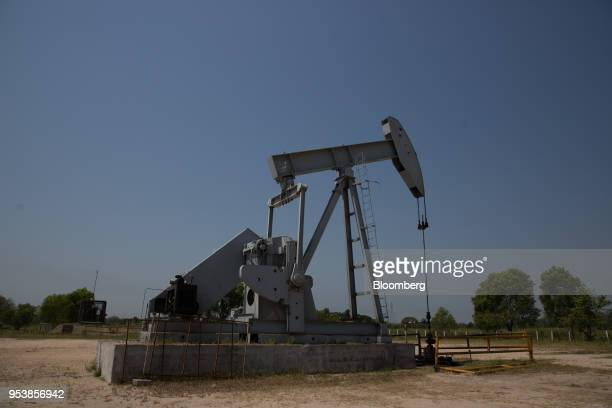 A Petroleos Mexicanos oil pump stands in Villahermosa Tabasco State Mexico on Wednesday April 18 2018 In Mexico's oil heartland they're swinging...