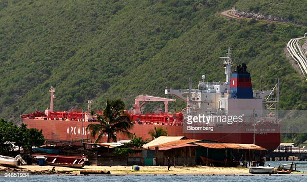 A petroleum cargo ship is docked in the Guaraguao wharf at the Petroleos de Venezuela SA PDVSA plant in Puero La Cruz Venezuela Sunday July 23 2006...