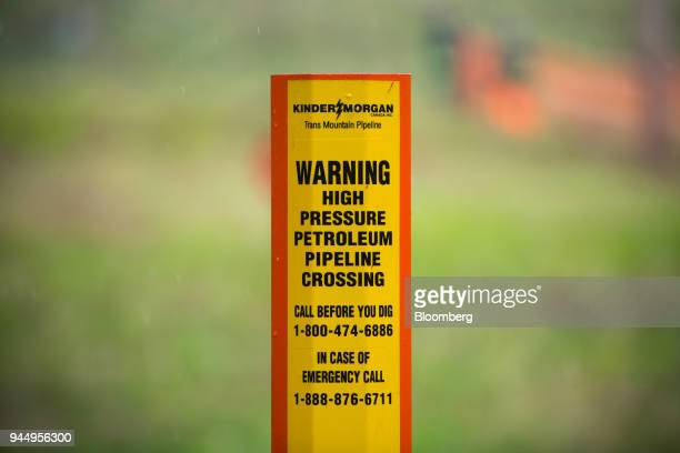 A petroleum pipeline crossing marker stands near the Kinder Morgan facility in Burnaby British Columbia Canada on Wednesday April 11 2018 Alberta the...