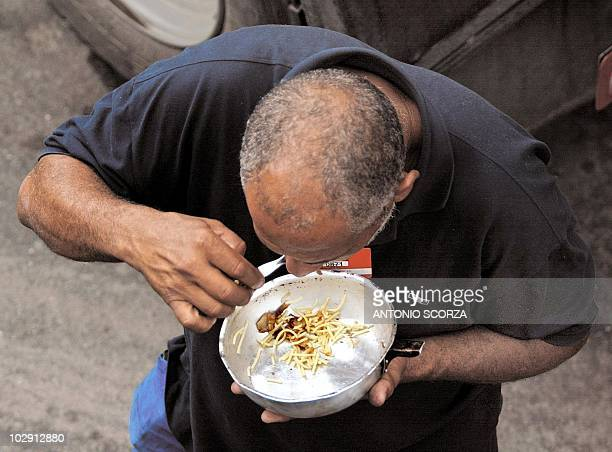 A petroleum product tanker truck driver eats outside the Duque de Caxias refinery some 70km from Rio de Janeiro 02 May 2002 at the start of a 24hour...