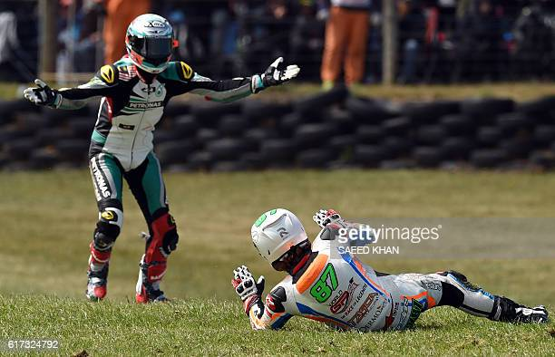 Petronas Raceline Malaysia's rider Hafizh Syahrin reacts following a collision with Tasca racing Scuderia's Australian rider Remy Gardner during the...