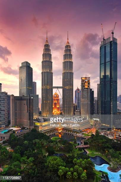 petronas towers against sky during sunset - petronas towers stock pictures, royalty-free photos & images