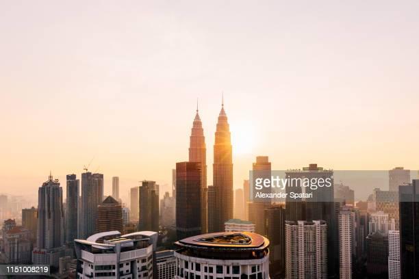 petronas towers and kuala lumpur skyline at sunrise, malaysia - malaysia stock pictures, royalty-free photos & images