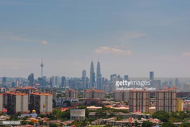 Petronas Towers And Kuala Lumpur Tower In City Against Sky
