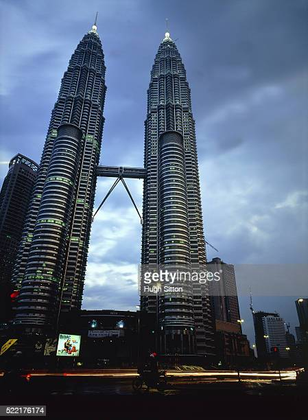 petronas towers in kuala lumpur in the evening, malaysia - hugh sitton stock pictures, royalty-free photos & images