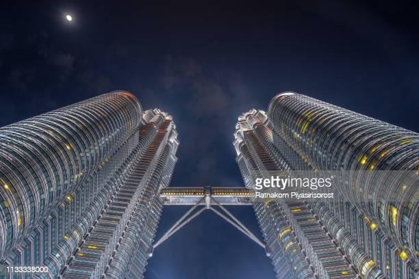 petronas twin tower, kuala lumpur, malaysia - menara kuala lumpur tower stock photos and pictures