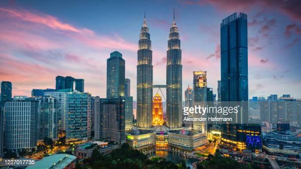 petronas twin towers sunset twilight panorama kuala lumpur malaysia - petronas towers stock pictures, royalty-free photos & images