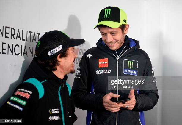 Petronas Yamaha SRT French driver Franco Morbidelli speaks with Monster Energy Yamaha MotoGP Italian driver Valentino Rossi before a press conference...