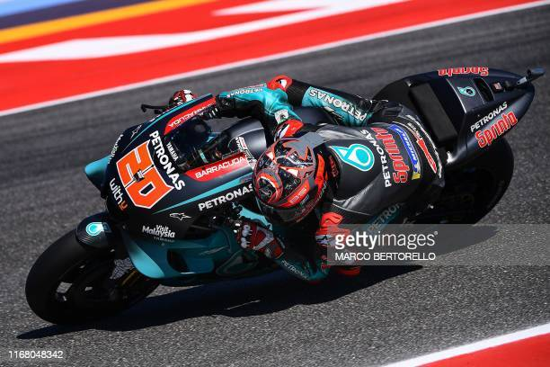 Petronas Yamaha SRT French rider Fabio Quartararo steers his motorbike during a free practice session ahead of the San Marino MotoGP Grand Prix race...