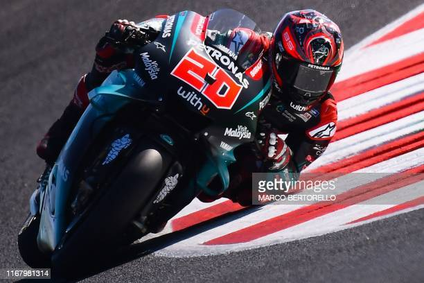 Petronas Yamaha SRT French rider Fabio Quartararo takes a curve during a free practice session ahead of the San Marino MotoGP Grand Prix race at the...