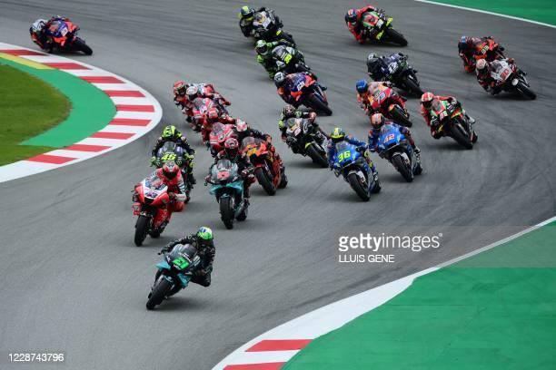 Petronas Yamaha SRT' Italian rider Franco Morbidelli leads after the start of the MotoGP race of the Moto Grand Prix de Catalunya at the Circuit de...