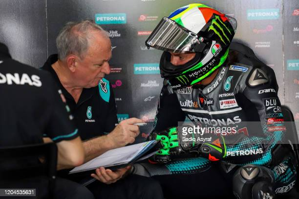 Petronas Yamaha SRT Italian rider Franco Morbidelli listens to the mechanic in his team's garage during the MotoGP preseason test at the Sepang...