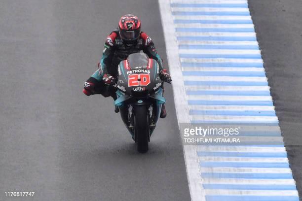 Petronas Yamaha SRT rider Fabio Quartararo of France goes into the corner during the MotoGP third free practice session of Japanese motorcyle Grand...