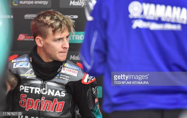 Petronas Yamaha SRT rider Fabio Quartararo of France holds a meeting in his pit after the MotoGP third free practice session of Japanese motorcyle...