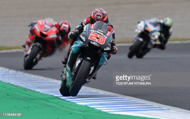 Petronas Yamaha SRT rider Fabio Quartararo of France leads Ducati Team rider Danilo Petrucci of Italy during the second free practice session at the...
