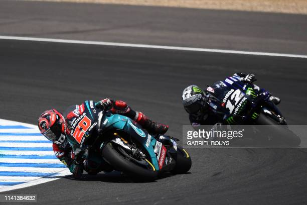 Petronas Yamaha SRT's French rider Fabio Quartararo and Monster Energy Yamaha' Spanish rider Maverick Vinales compete during the MotoGP race of the...