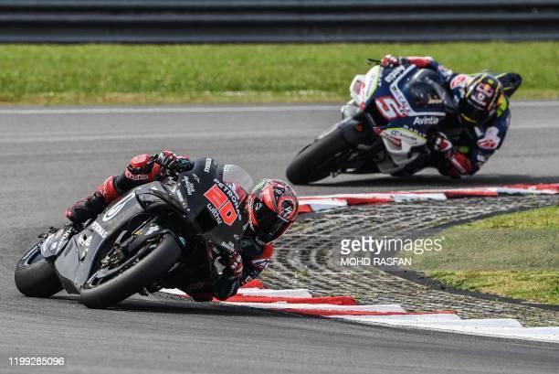 Petronas Yamaha SRT's French rider Fabio Quartararo and Reale Avintia Racing Ducati's French rider Johann Zarco take a corner during the second day...