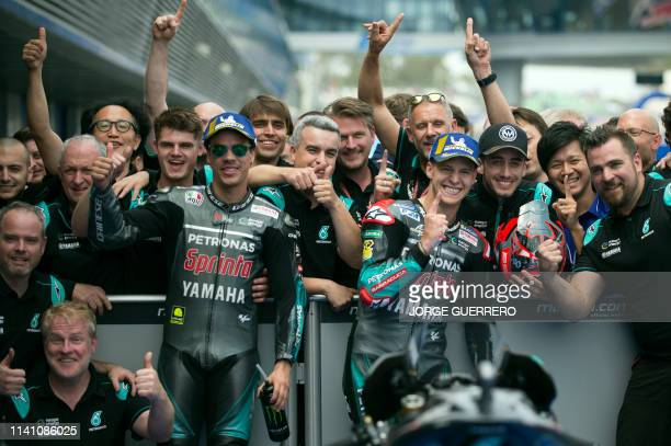 TOPSHOT Petronas Yamaha SRT's French rider Fabio Quartararo celebrates after earning the pole position for tomorrow's race beside second placed...